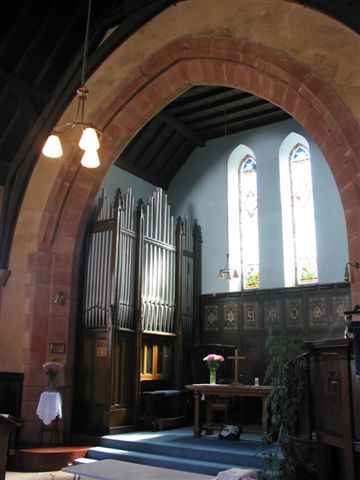 Organ, communion table and pulpit.